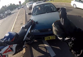biker makes sure driver is ok after accid