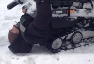 man gets devoured by his snow mobil
