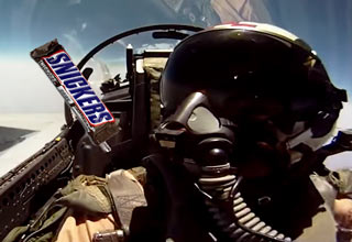 pilot passes snickers to co-pilot in fighter jet