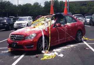 red car gets vandalize