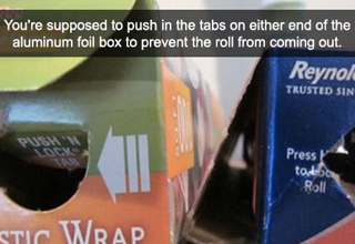 You're supposed to push in the tabs on either end of the aluminum foil box to prevent the roll from coming out.