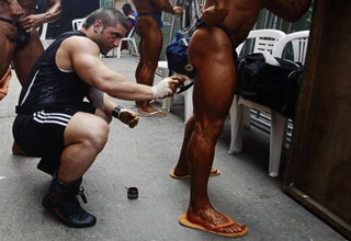 man shaving body builders butt