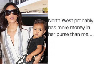 pic of Kim Kardashian holding North West, who is holding a purse.