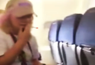 woman smokes cigarette on airplane