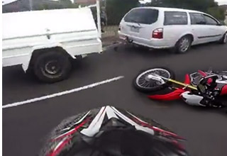biker follows too closely and hits trailer