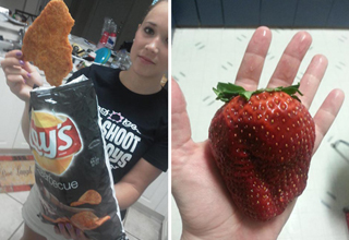 woman holding a giant lays chip. man holding a giant strawberry the size of a human heart.