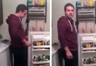 man opens fridge sees beer that says daddys beer looks at c