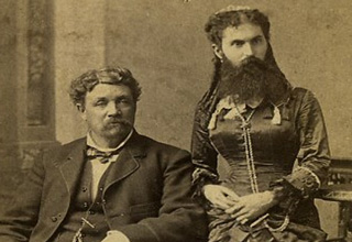 old timey photo of man and bearded wife