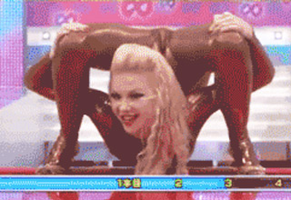 blonde girl doing limbo on Japanese game show