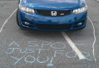 Car parked like a jerk. Text reads: A spot just for you!