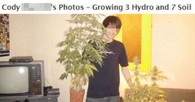 Cody holding pot plants in his living room
