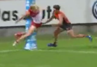 Rugby Player Tackled Into The Goal Post