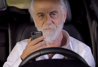 Tommy Chong talking on cellphone during commercial