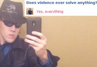 Dumb guy in a fedora takes a picture of himself and says violence solves everything.