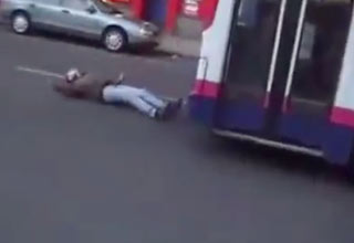 Drunk Dude Gets Knocked Down By Bus
