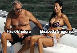 flavio briatore sitting on a boat with elisbaetta gregoraci