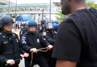 confrontation between baltimore riot police and black man