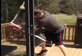 man destroying screen door