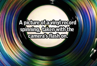 a colorful image of a vinyl record spinning and light from the camera's flash