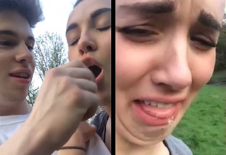 guy pranks his girlfriend by shoving a dandelion in her mouth