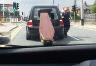 coffin falls out of