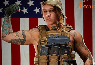buff girl in front of american flag with tactical gear on