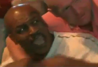 fan with arm around angry mike tyson