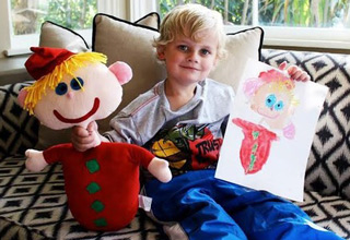blonde kid with drawing of blonde kid with blonde kid toy