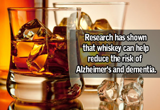 glass of whiskey with text that says whiskey can help reduce the risk of alzheimer's and d