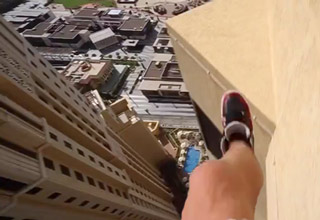 man jumps between ledges high above the ground