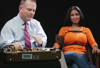 woman hooked up to lie detector test