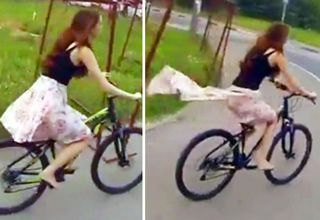 girl on bicycle gets her skirt caught on fence