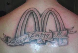 guy with mcdonalds arches tattoo on his back