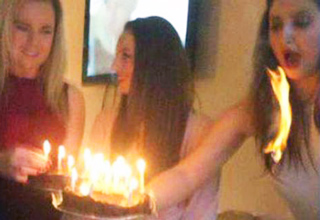 girls hair lit on fire from birthday candle