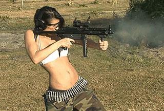 hot girl shooting a gun
