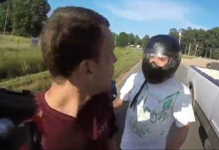a biker confronts a wreckless driver