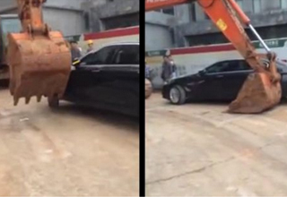Company in China Fed up With Illegal Parking Rents an Excavator