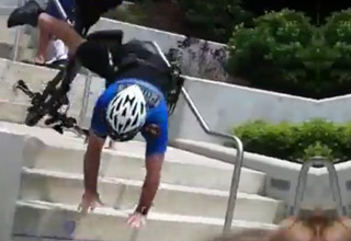 Bicycle Cop Falls Down The Stai