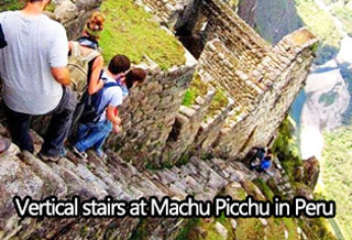 a picture of steep stairs on a mountain in machu picchu in peru.
