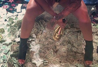 stripper standing on top of 1 dollar bills