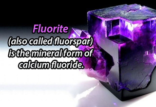 a piece of flourite, a purple cubed stone