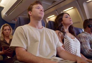young couple on a plane