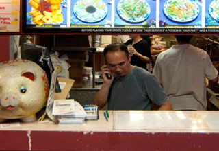 old man on the phone at chinese resturant