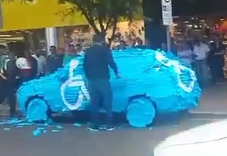 mans car covered in post it notes for parking in handicapped spot