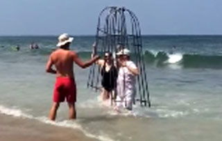Couple Tries To Use Homemade Shark Cage At The Beach