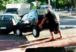 Buff Biker Lifts Car Off of Bike Path