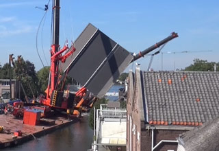 Two Giant Cranes Fall Into Some Houses