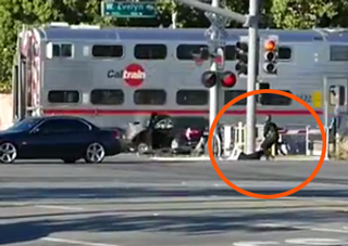 Deputy Saves Man's Life Seconds Before A Train Hits His Car