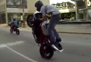 Show-off Biker Taunts Cop And Gets Awa
