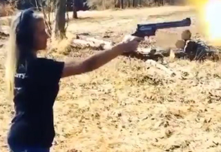 Girl Handles Huge Gun Well!